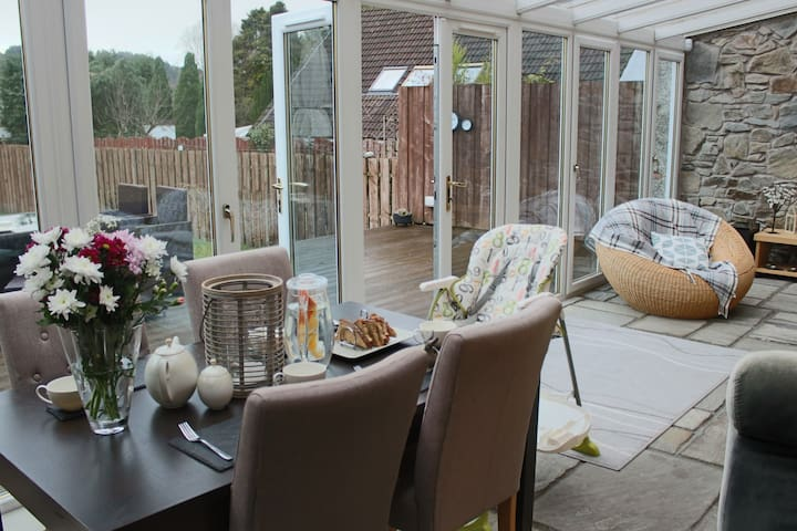 Conservatory with dining table is warm throughout the year.