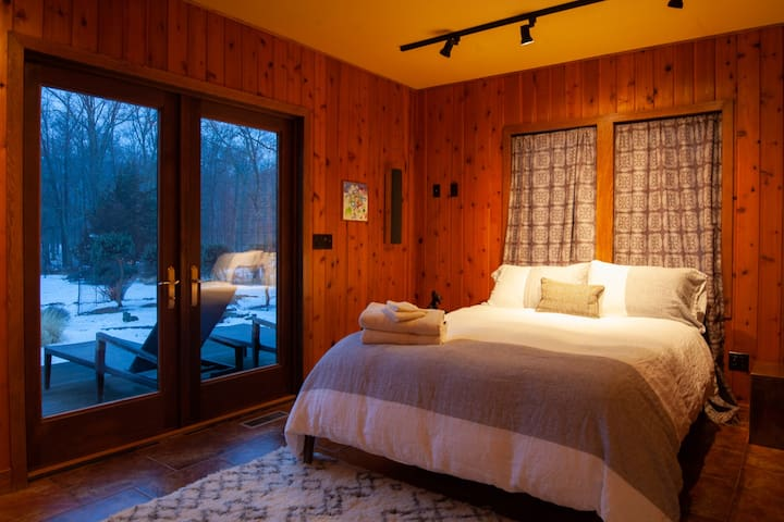 First guest bedroom has a home theater and direct outlet to the outside deck.