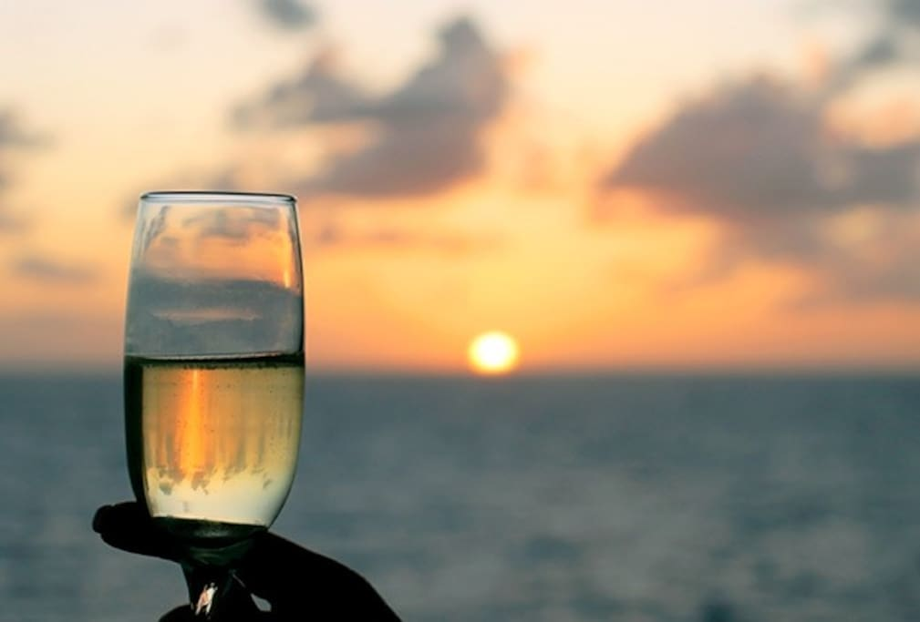 Catch the sunset while sitting outside on the large private balcony
