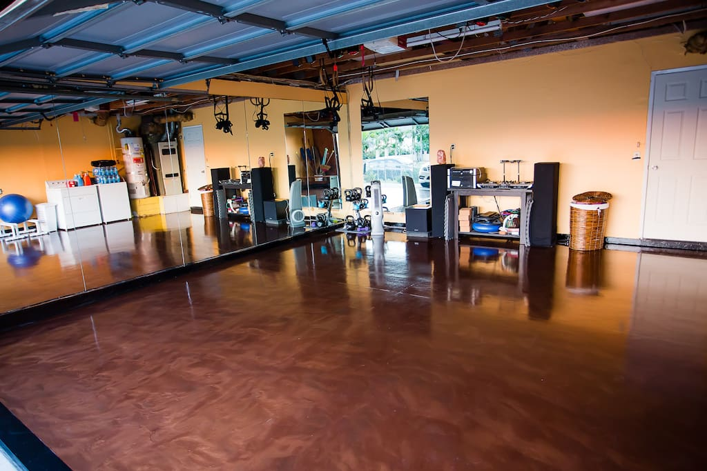 State of the art dance / movement studio.  Get in shape, practice Yoga, dance and much more.  Features brand new metallic epoxy floors, gymnastic rings, parallette bars, and mirrors wall to wall.