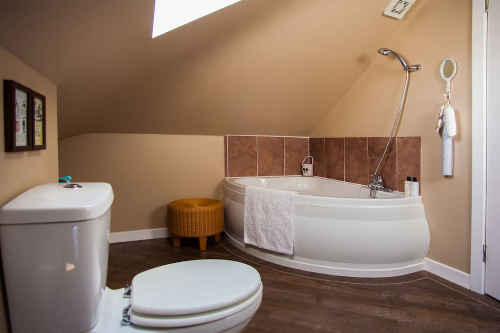 The bathroom is for your exclusive use and is on the same floor as your rooms. It is large but has low ceilings. The shower is over the corner bath and as it's in the eaves  if you're tall, you may need to watch your head....