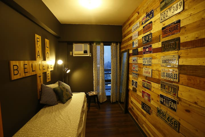 a closer look of the guest room inspired with our love for scrabble and our travels.