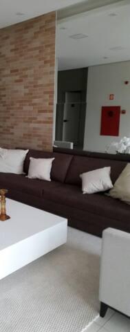 Suite com ar+Wi-Fi em apartamento  (so mulher)