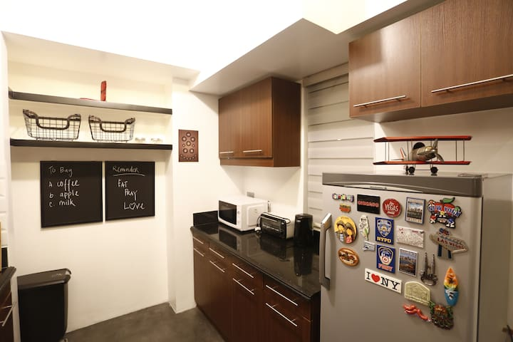 kitchen - complete with microwave oven, oven toaster, electric kettle, induction cooker, rice cooker, cooking utensils, etc.