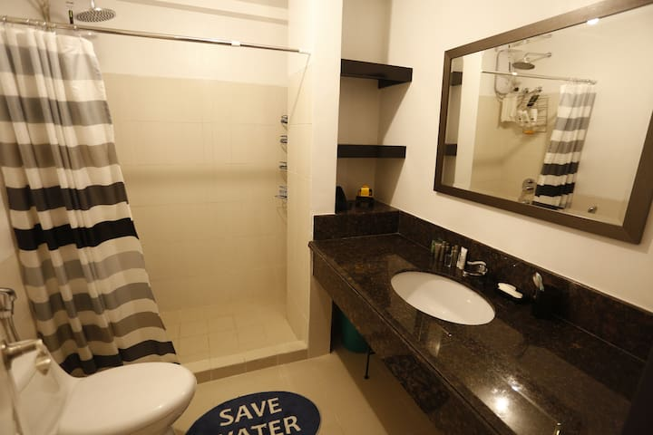 Comfort Room is complete with hot shower, toilet bidei, bath towels, and simple toiletries.