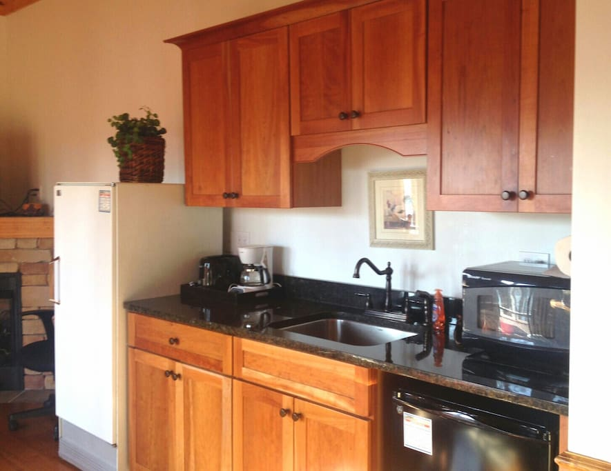 Cabins feature a small kitchenette with stove, refrigerator. microwave, small coffee pot.