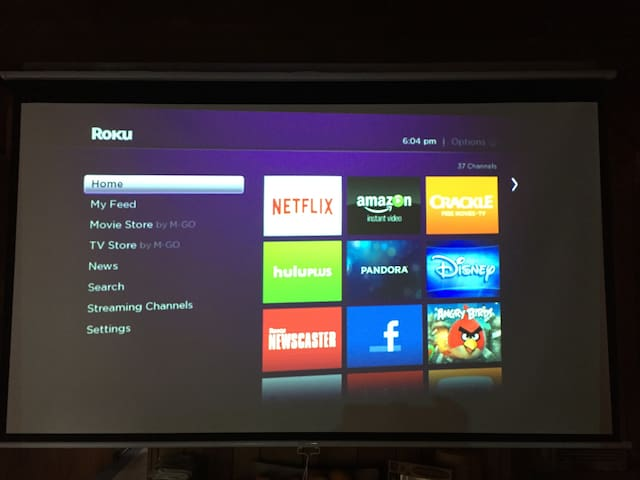 This projector is in the living room and it's connected to a Roku X2 player. You can also connect your phone, or laptop to play your own movies.