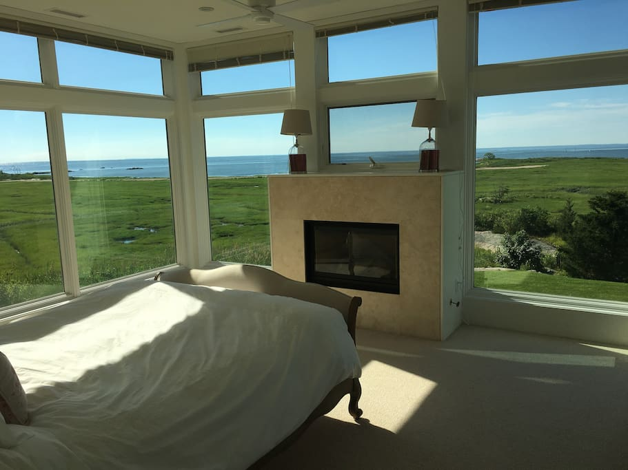 Master bed with uninterrupted views of Long island sound and a built in fire for cosy winter evenings