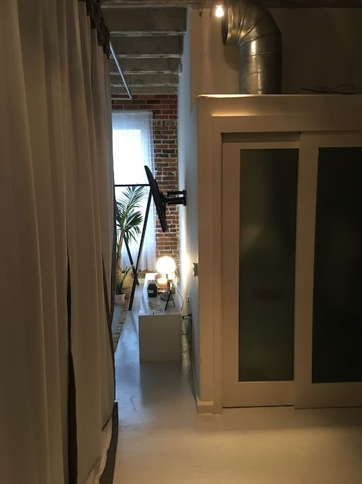 "This is the ""doorway"" - I have curtains hung for my wall. This is the entry to the room / from the loft living room."