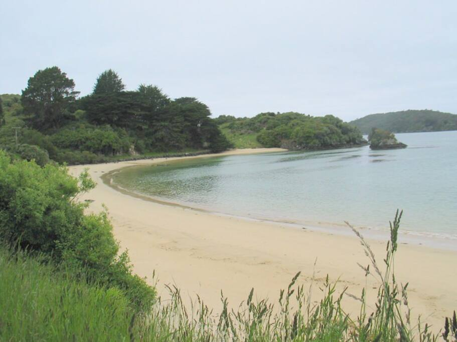 Secluded beach below Apartment