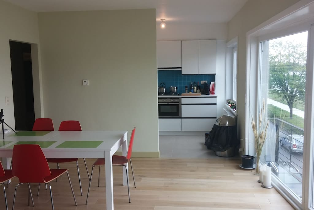 Dining table with open kitchen