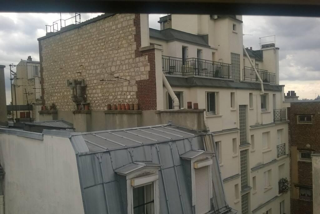 Velux donnant sur les fameux toits parisiens