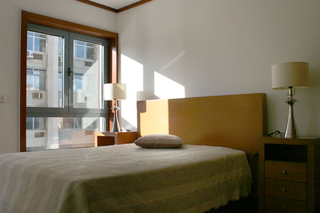 Master suite bedroom with private bathroom and two windows overlooking Gulbenkian  Modern Art Center