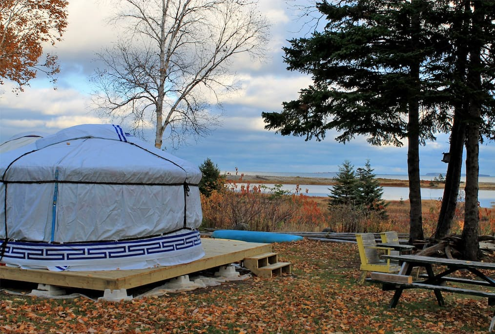 It sits on a private deck with pond and ocean view, next to picnic tables and a fire pit
