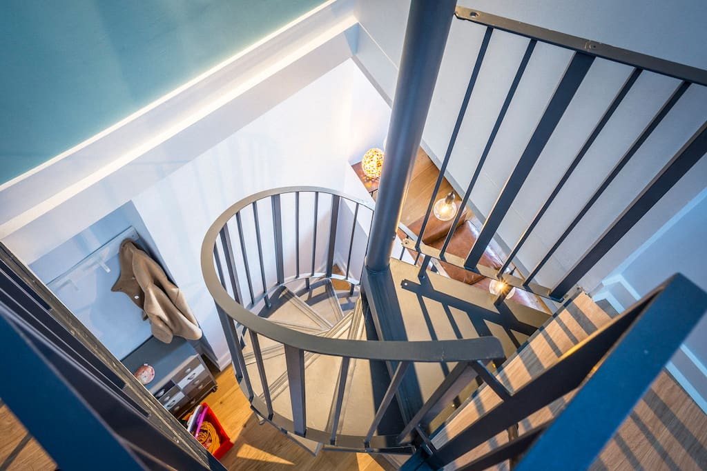 Spiral staircase to master bedroom