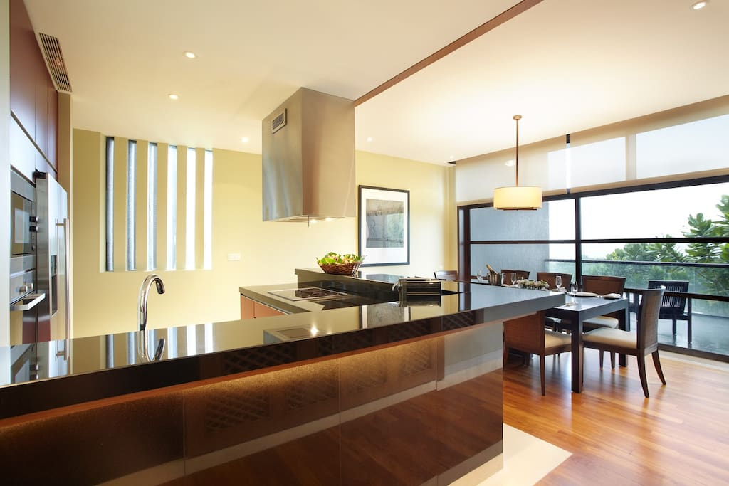 Designer kitchen appliances with island concept dining table
