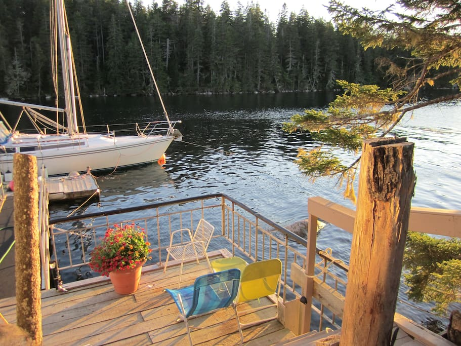 Lower deck for relaxing with ramp to floating dock & swim  ladder
