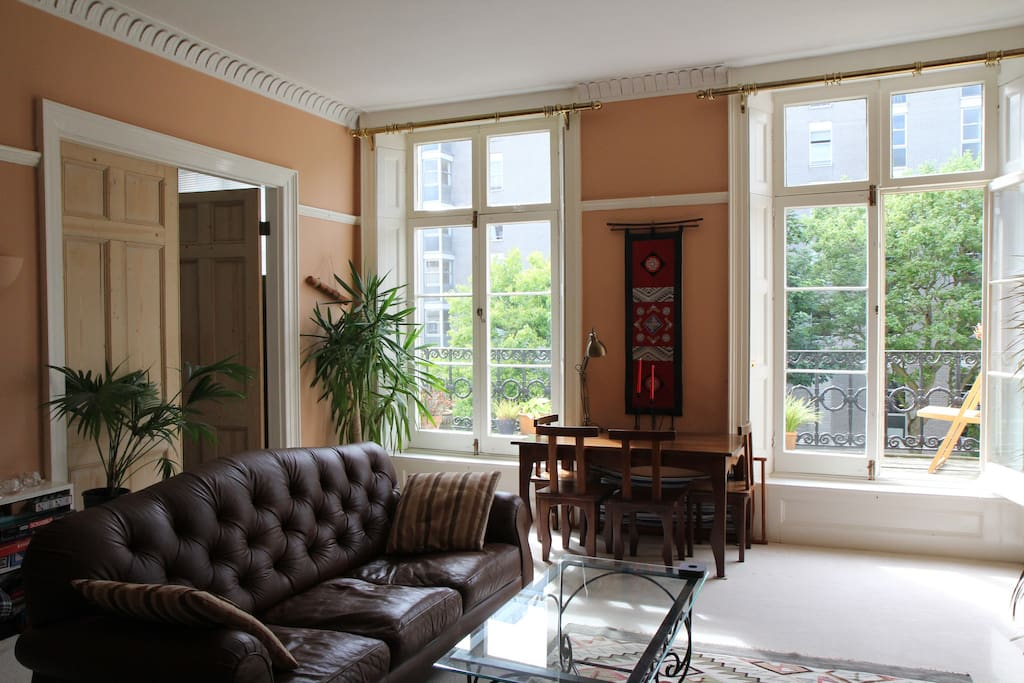 Large, bright lounge has two sets of patio doors that open onto the balcony.
