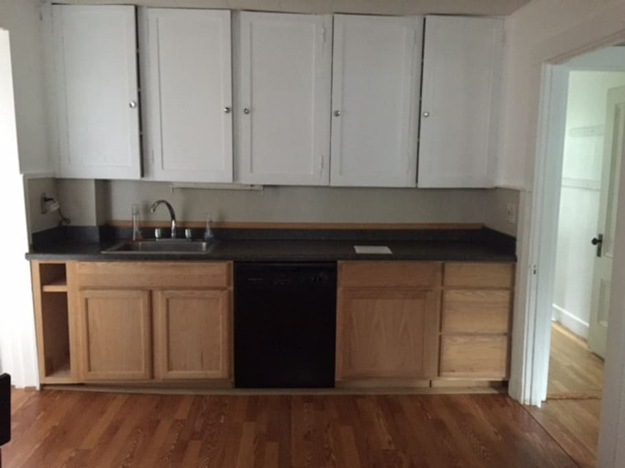 other side of kitchen showing sink and dishwasher