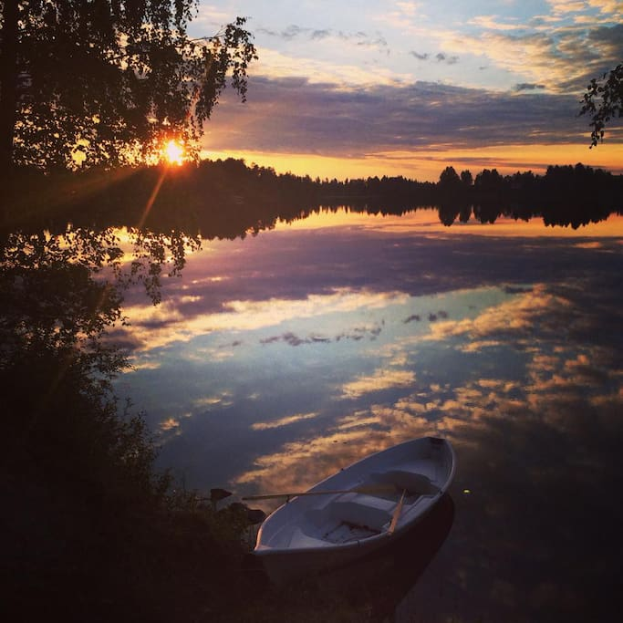 row boat, lake, midnight sun