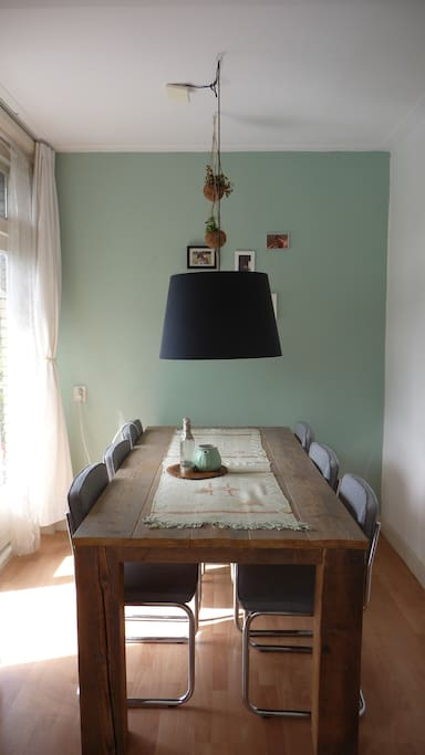 Bright and charming living room, dining table