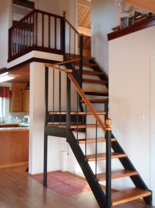 The stairs to the loft with 2 bedrooms and a bathroom.
