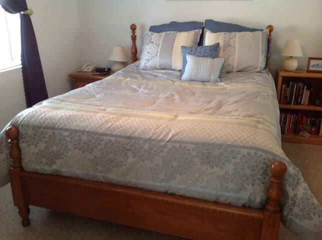 The bedroom has a comfortable queen size bed.
