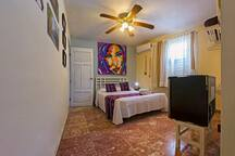 Bedroom double size bed, A/C, safety box, hanger, TV, minibar, ceiling fan