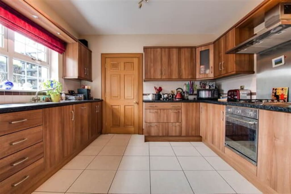 Kitchen with microwave and fridge and cooking facilities.