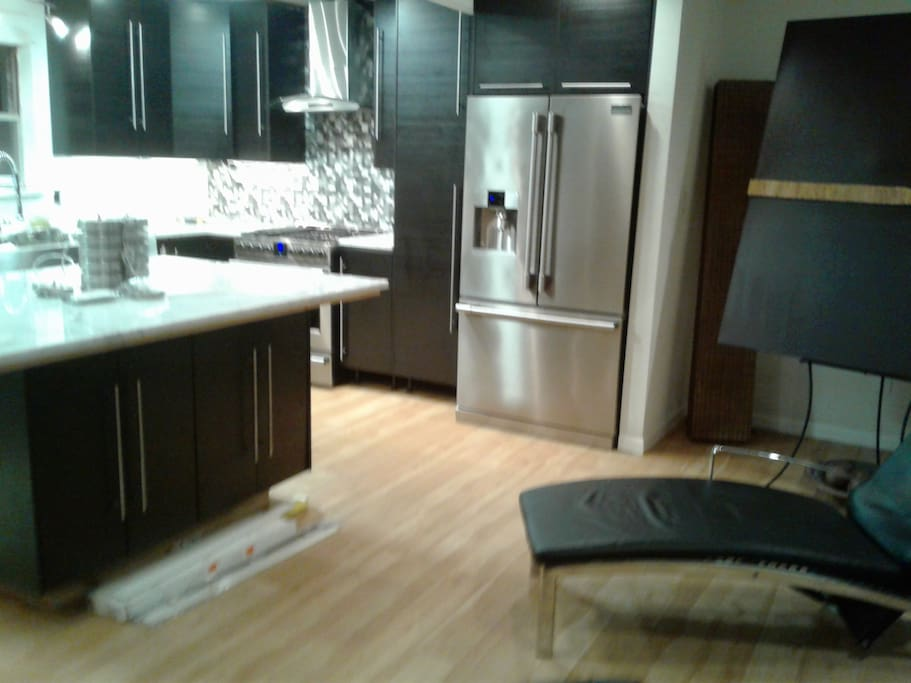 Open Kitchen w/Stainless steel appliances, microwave and dishwasher