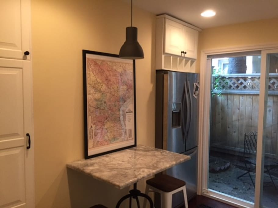 Kitchen with granite countertop and seating for two.
