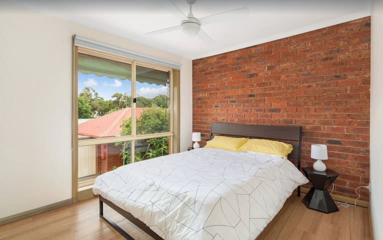 Comfortable queen bed with spacious window