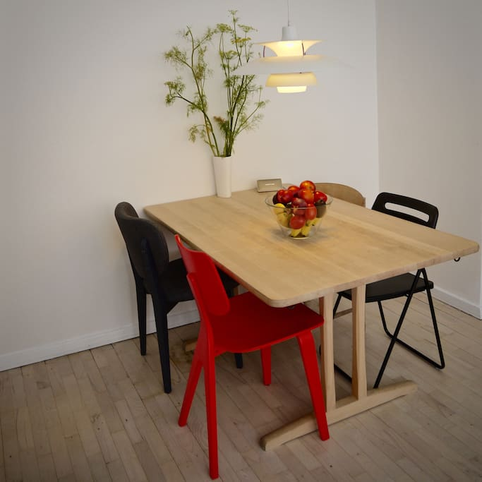 Dining table in living room, can be extended if needed
