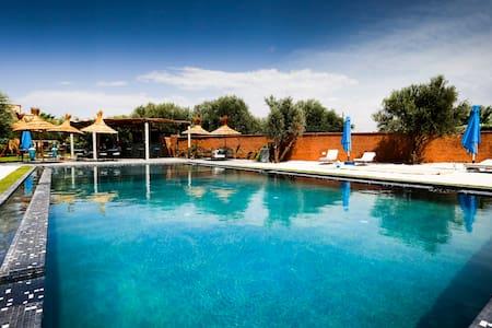 Chambre Zitoune accès piscine - La palmeraie