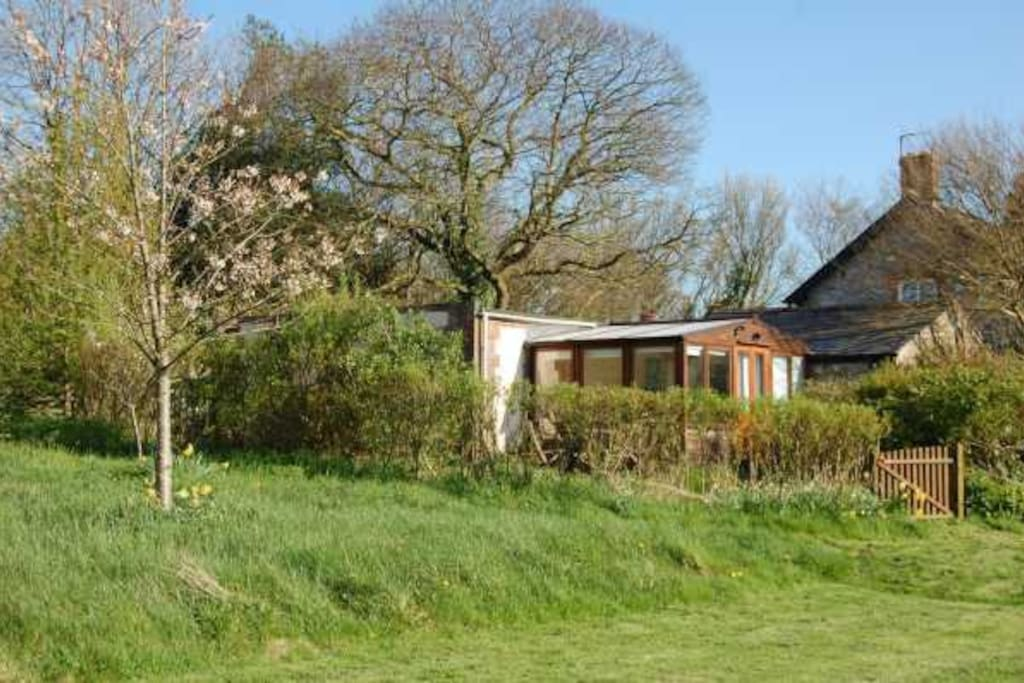 Set in an acre of orchards and mixed woodland.