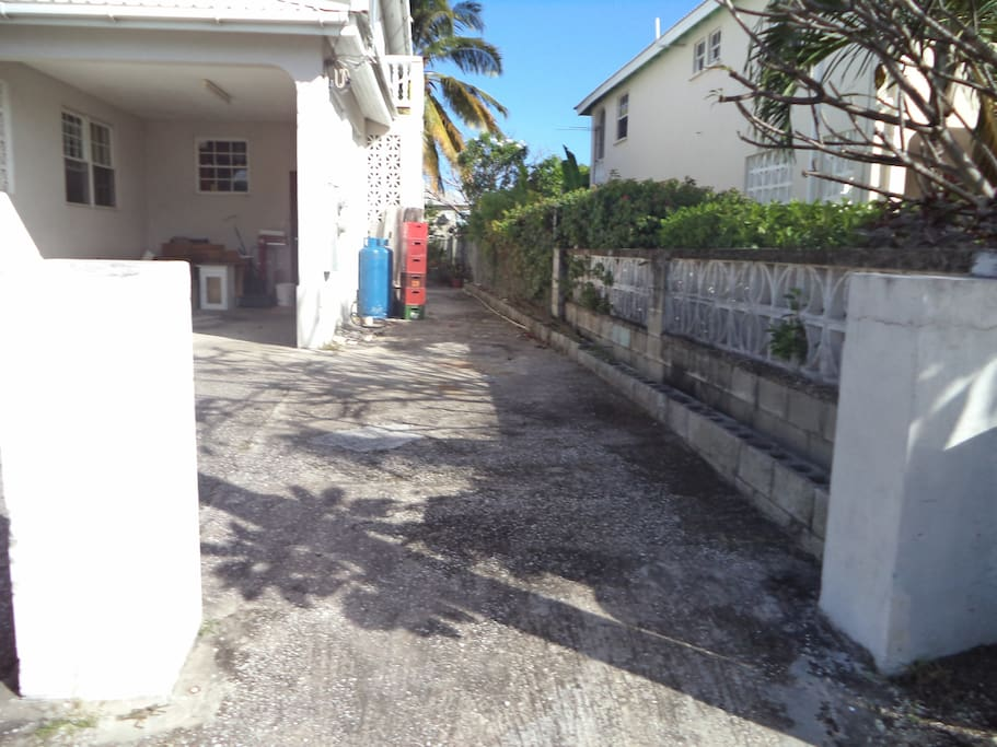 Lighted, paved path way that leads to the separate entrance to apartment