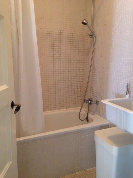 Bathroom with shower and bath