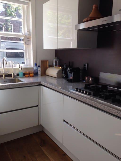 Kitchen with dishwasher, oven, stove, fridge and freezer.