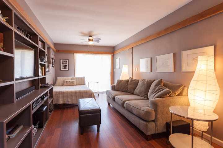 The bedroom suite also doubles as a cozy TV room. Streaming services and a sound bar for the ultimate popcorn and movie night. Some furnishings have been updated.