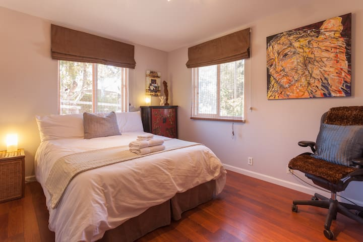 Bedroom 2 - Bed linens and chair have since been updated. Now includes desk and comfortable and elegant task chair.
