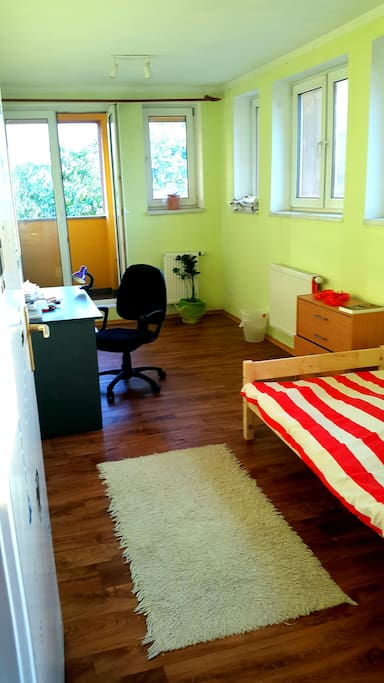 Room no 1 - single bed, drawer, armchair, balcony, desk
