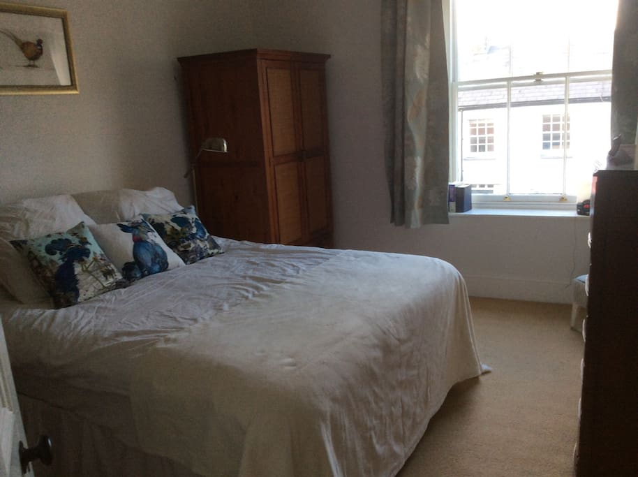 Spacious and light double bedroom with plenty of storage space for your clothes