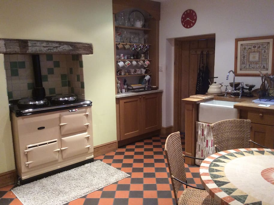 Make your morning cuppa on the Aga in the kitchen which overlooks the courtyard garden