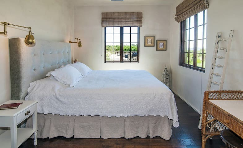 Bedroom with king size bed and vineyard views