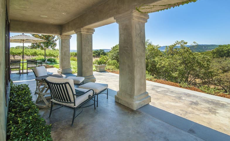 Patio with vineyard and rolling hills view for relaxing and dining.