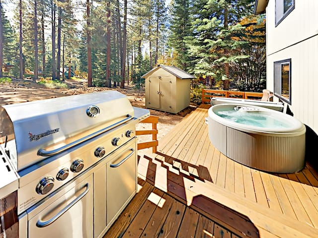Breathe the fresh mountain air on the deck, equipped with a private hot tub and forested views.