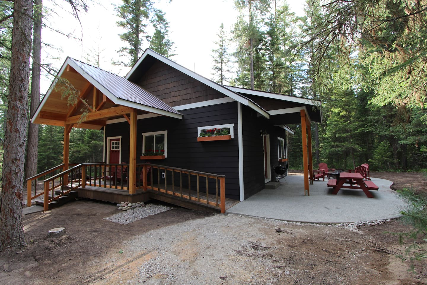Secluded and private new cabin in the woods with patio, deck, porch, wheelchair access ramp.