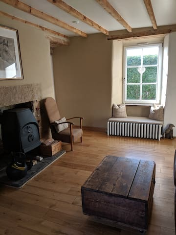 Duel aspect, cosy but large living room with ample seating and a wood burning stove.