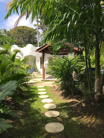 A quiet stroll through the villa's lush tropical gardens.