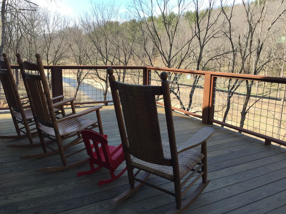 Relax in a rocker on the porch overlooking the river.  This is early spring before everything turns green.